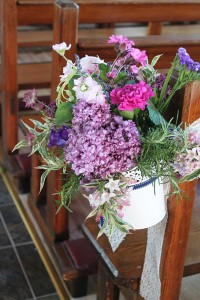 A bucketful of garden flowers and herbs